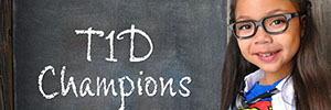 'T1D Champion', little girl in Superwoman costume and chalkboard